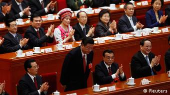 China's newly-elected President Xi Jinping bows during the fourth plenary meeting of the National People's Congress (NPC) at the Great Hall of the People in Beijing, March 14, 2013. China's parliament formally elected heir-in-waiting Xi as the country's new president on Thursday, succeeding Hu Jintao, putting the final seal of approval on a generational transition of power. REUTERS/Barry Huang (CHINA - Tags: POLITICS)