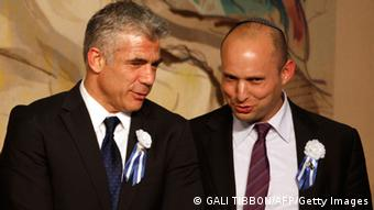 Israeli politician Yair Lapid (L), leader of the Yesh Atid party, speaks to Naftali Bennett, head of the Israeli hardline national religious party the Jewish Home February 5, 2013 in Jerusalem.