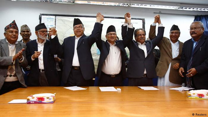 Prime Minister Baburam Bhattarai (4th L) with the leader of four major political parties join hands in front of the media after signing an agreement to form a government led by chief justice Khilraj Regmi in Kathmandu March 13, 2013. REUTERS/Navesh Chitrakar (NEPAL - Tags: POLITICS)