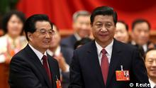 Hu Jintao (L) shakes hands with China's newly elected President and chairman of the Central Military Commission Xi Jinping during the fourth plenary meeting of the first session of the 12th National People's Congress (NPC) in Beijing, March 14, 2013. REUTERS/China Daily (CHINA - Tags: POLITICS) CHINA OUT. NO COMMERCIAL OR EDITORIAL SALES IN CHINA