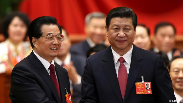 Hu Jintao (L) shakes hands with China's newly elected President and chairman of the Central Military Commission Xi Jinping during the fourth plenary meeting of the first session of the 12th National People's Congress (NPC) in Beijing, March 14, 2013. (Photo: Reuters)