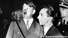 Adolf Hitler and Dr.Joseph Goebbels as they appeared at one of the 50 rallys held as part of the Nazi Election Campagin. November 1933.