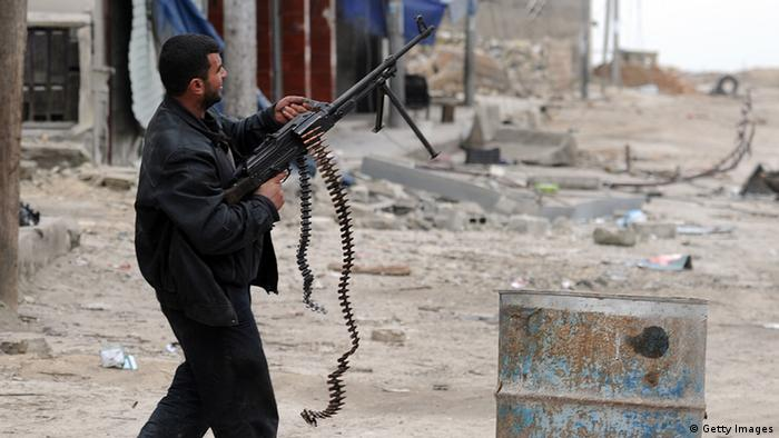 A Syrian rebel aims his weapon towards a position held by regime forces during clashes in the northern city of Aleppo on February 8, 2013.