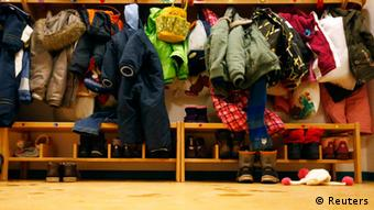 Winter boots and clothing of children are stored in shelving at a Kindergarten in Hanau REUTERS/Kai Pfaffenbach