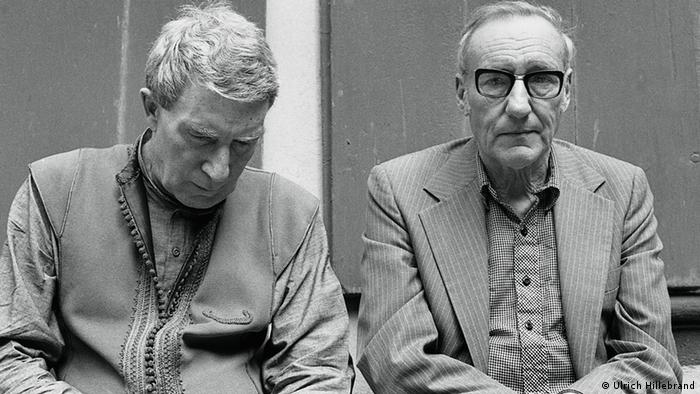 Brion Gysin and William S. Burroughs in front of the Pharmaceutical Museum in Basel, 1979.