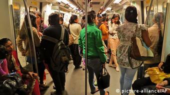 Indian women travel inside a Women Only metro train compartment (AP Photo/Yirmiyan Arthur)