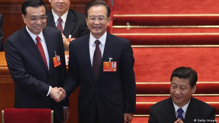 BEIJING, CHINA - MARCH 15: China's newly-elected Premier Li Keqiang (L) shakes hands with former Chinese Premier Wen Jiabao near Chinese President Xi Jinping (R) during the fifth plenary meeting of the National People's Congress at the Great Hall of the People on March 15, 2013 in Beijing, China. Li Keqiang was elected as China's Premier Friday at the 12th National People's Congress, the country's top legislature. (Photo by Feng Li/Getty Images)