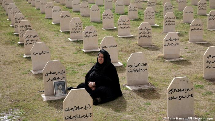 An Iraqi Kurdish woman visits the grave of her relative, Omar Mustafa who was killed in a gas attack by former Iraqi president Saddam Hussein in 1988 at the memorial site of the victims in the Kurdish town of Halabja, 300 kms (190 miles) northeast of Baghdad on March 16, 2012. Some 5,000 civilians, mostly women and children, were killed in the chemical gas attack by Saddam Hussein's airforce as part of a campaign to crush a Kurdish rebellion. AFP PHOTO/SAFIN HAMED (Photo credit should read SAFIN HAMED/AFP/Getty Images)