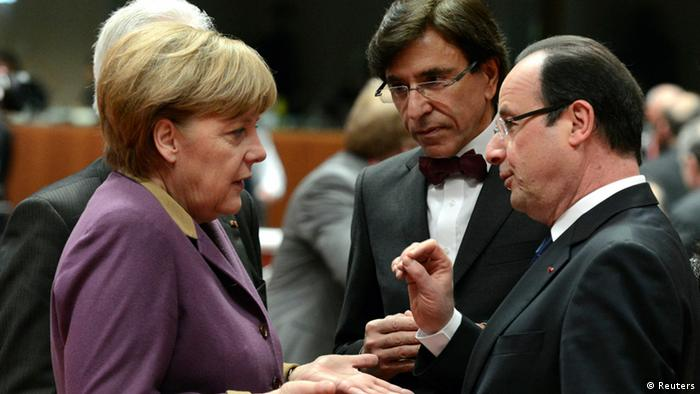 Germany's Chancellor Angela Merkel (L), France's President Francois Hollande (R) and Belgium's Prime Minister Elio Di Rupo speak at a European Union (EU) leaders summit in Brussels March 15, 2013. European leaders gathered in Brussels on Friday with differences over austerity and how best to tackle the social costs of the debt crisis set to dominate their two-day summit. REUTERS/Laurent Dubrule (BELGIUM - Tags: POLITICS BUSINESS EMPLOYMENT)