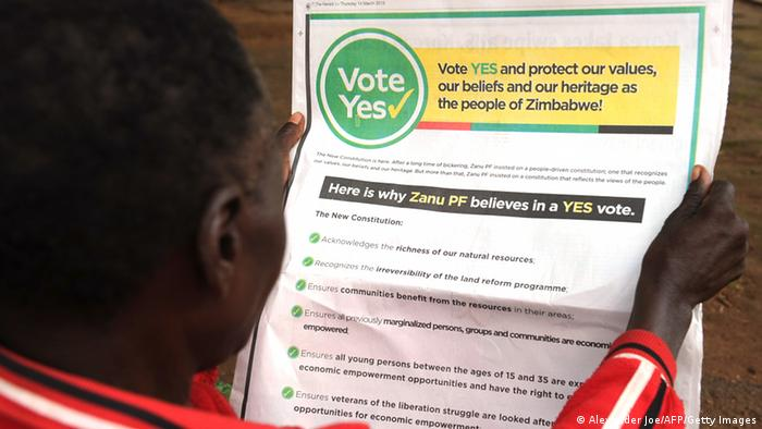 A man reads a newspaper ad calling on Zimbabweans to vote yes for the constitutional referendum. (Photo: ALEXANDER JOE/AFP/Getty Images)