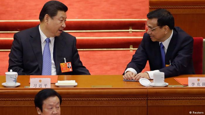 China's newly-elected President Xi Jinping (top L) talks to newly-elected Premier Li Keqiang during the sixth plenary meeting of the National People's Congress (NPC) at the Great Hall of the People in Beijing, March 16, 2013. REUTERS/Jason Lee (CHINA - Tags: POLITICS)