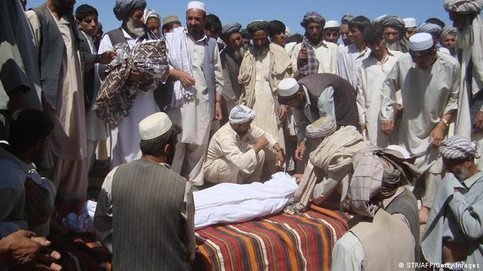 Members of the community attend a funeral after a NATO airstrike destroyed two fuel tankers hijacked by the Taliban in northern Kunduz on September 4, 2009. (Photo: STR/AFP/Getty Images)