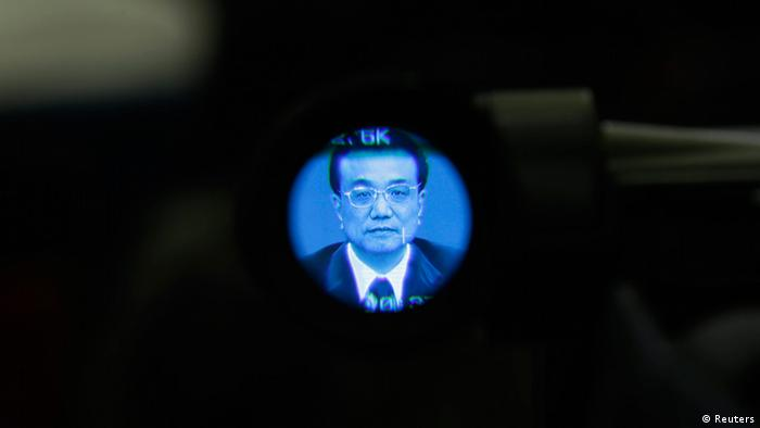 China's newly elected Premier Li Keqiang is seen through a video camera during a news conference after the closing session of the National People's Congress (NPC) at the Great Hall of the People in Beijing, March 17, 2013. REUTERS/Jason Lee (CHINA - Tags: POLITICS)