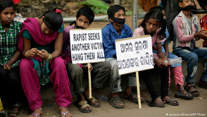 Indian children participate in a protest against child abuse and rising crimes against women, in Bhubaneswar, India, Saturday, March 16, 2013. India has seen outrage and widespread protests against rape and attacks on women and minors since a fatal gang-rape of a young woman in December on a moving bus in New Delhi, the capital. In the most recent case, a Swiss woman who was on a cycling trip in central India with her husband has been gang-raped by eight men, police said. Placard reads our safety is your responsibility. (AP Photo/Biswaranjan Rout)