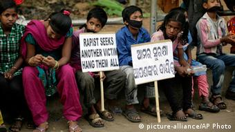 Indian children participate in a protest against child abuse and rising crimes against women, in Bhubaneswar, India, Saturday, March 16, 2013. (AP Photo/Biswaranjan Rout)