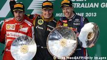 First placed Lotus driver Kimi Raikkonen of Finland (C), second placed Ferrari driver Fernando Alonso of Spain (L) and Red Bull driver Sebastian Vettel of Germany (R), stand on the podium following the Formula One Australian Grand Prix in Melbourne on March 17, 2013. IMAGE STRICTLY RESTRICTED TO EDITORIAL USE - STRICTLY NO COMMERCIAL USE AFP PHOTO / Greg WOOD (Photo credit should read GREG WOOD/AFP/Getty Images)