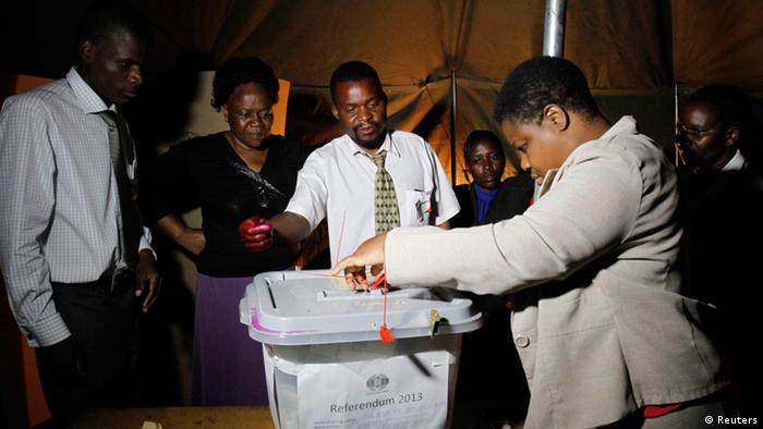 An election official seals a ballot box after the close of voting on a referendum in Mbare, Harare, March 16, 2013. REUTERS/Philimon Bulawayo (ZIMBABWE - Tags: POLITICS ELECTIONS)