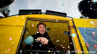 David Hasselhoff is showered with confetti as he is addressing fans and campaigners at the East Side Gallery on March 17, 2013