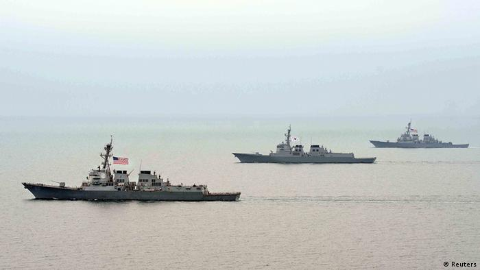 Navy vessels of South Korea and the U.S. participate in a joint military drill on the west sea, west of Seoul, in this picture taken March 17, 2013 and released by the South Korean Navy on March 18, 2013. REUTERS/South Korean Navy/Handout (SOUTH KOREA - Tags: MILITARY POLITICS) ATTENTION EDITORS � THIS IMAGE WAS PROVIDED BY A THIRD PARTY. FOR EDITORIAL USE ONLY. NOT FOR SALE FOR MARKETING OR ADVERTISING CAMPAIGNS. SOUTH KOREA OUT. NO COMMERCIAL OR EDITORIAL SALES IN SOUTH KOREA. THIS PICTURE IS DISTRIBUTED EXACTLY AS RECEIVED BY REUTERS, AS A SERVICE TO CLIENTS