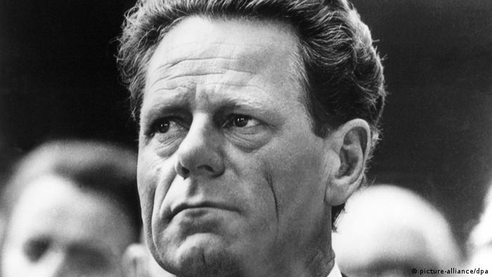 Black-and-white image of Hans Küng in 1975, looking worried.