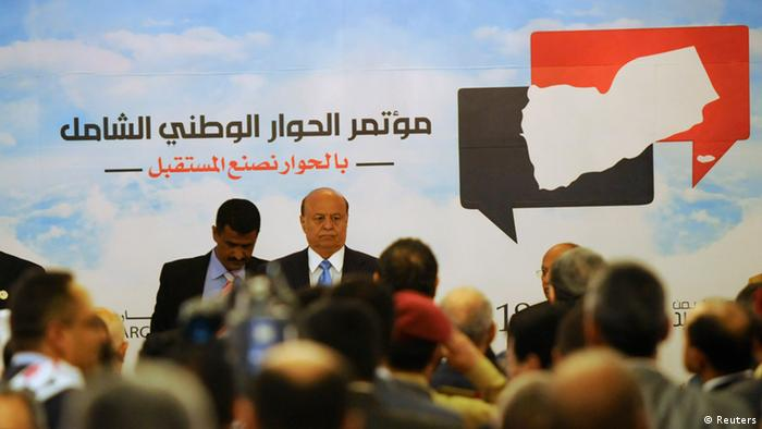 Yemen's President Abd-Rabbu Mansour Hadi attends the opening of a national dialogue conference in Sanaa March 18, 2013. Yemeni leaders trying to end political upheaval and separatist demands met to chart a new constitution on Monday, the scale of their task underscored by protesters who marched in their tens of thousands in the south to demand their own state. REUTERS/Mohammed Hamoud (YEMEN - Tags: POLITICS)