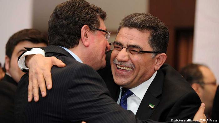 Ghassan Hitto (R) hugs a delegate to celebrate his being elected as the prime minister of the interim government of Syria's opposition, in Istanbul, Turkey, March 19, 2013. The Syrian opposition coalition elected Ghassan Hitto as the prime minister of its interim government