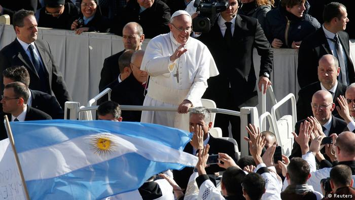 Pope Francis approaches priests with an Argentine flag as he arrives in Saint Peter's Square for his inaugural mass at the Vatican, March 19, 2013. Pope Francis celebrates his inaugural mass on Tuesday among political and religious leaders from around the world and amid a wave of hope for a renewal of the scandal-plagued Roman Catholic Church. REUTERS/Stefano Rellandini (VATICAN - Tags: RELIGION POLITICS)