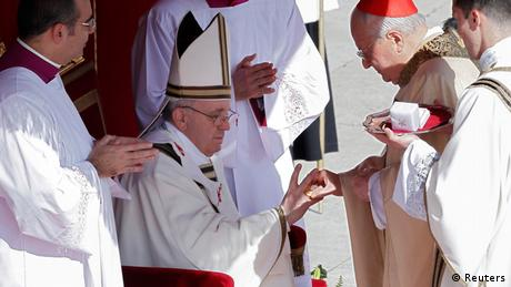 The Fisherman's Ring is placed on the finger of Pope Francis by Cardinal Angelo Sodano (R), Dean of the College of Cardinals during his inaugural mass at the Vatican, March 19, 2013. Pope Francis celebrates his inaugural mass on Tuesday among political and religious leaders from around the world and amid a wave of hope for a renewal of the scandal-plagued Roman Catholic Church. REUTERS/Stefano Rellandini (VATICAN - Tags: RELIGION POLITICS TPX IMAGES OF THE DAY)