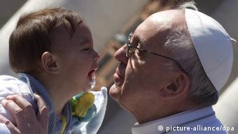 epa03631201 Pope Francis kisses a child as he arrives in St. Peter's square for his inauguration mass, Vatican City, 19 March 2013. Hundreds of thousands of faithful, as well as political and religious dignitaries from all over the world, were expected to attend the inauguration mass of Pope Francis. EPA/CLAUDIO PERI pixel