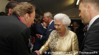 Queen Elizabeth II meets Sir Andrew Lloyd Webber and Gary Barlow backstage at The Diamond Jubilee Concert outside Buckingham Palace, London. (Photo: Dave Thompson/PA Wire)