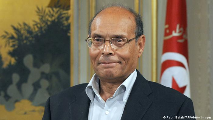 Tunisian President Moncef Marzouki is seen in his office prior to his meeting with Tunisian premier-designate Ali Larayedh on March 8, 2013, in Tunis. Larayedh unveiled a proposed new coalition government after a deal was reached in last-minute talks aimed at ending a major political crisis. AFP PHOTO / FETHI BELAID (Photo credit should read FETHI BELAID/AFP/Getty Images)