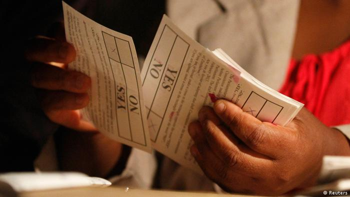 Hands holdi8ng ballot papers REUTERS/Philimon Bulawayo