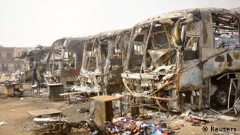 Destroyed buses after a bomb attack by Boko Haram that left atleast 25 people dead