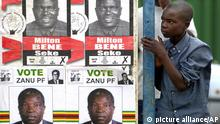 A boy stands against a bus shelter with election posters during an election rally by Morgan Tsvangirai, leader of the Movement for Democratic Change (MDC) in Ruwa, 15 kilometers east of Harare, Zimbabwe, Friday, March 25, 2005. Tsvangirai held the rally ahead of parliamentary elections set for March 31. (AP Photo Themba Hadebe)