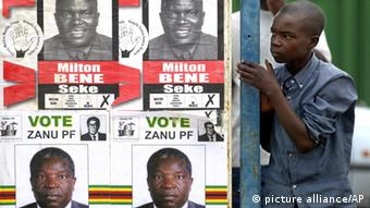 A boy stands against a bus shelter with election posters during an election rally by Morgan Tsvangirai, leader of the Movement for Democratic Change (MDC) in Ruwa. (AP Photo Themba Hadebe)