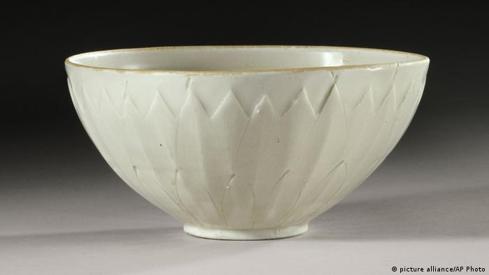 "This undated photo provided by Sotheby's Auction House in New York shows a 1,000-year-old Chinese ""Ding"" bowl from the Northern Song Dynasty. The bowl, purchased from a tag sale for no more than three dollars, was sold by Sotheby's for more than $2.22 million during the opening session of Sotheby's fine Chinese ceramics and works of art auction Tuesday, March 19, 2013 in New York. (AP Photo/Sotheby's Auction House)"