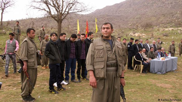 The eight prisoners stand in line before their liberty is granted Copyright: Karlos Zurutuza, Sergele, Iraqi Kurdistan, March 2013