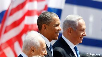 U.S. President Barack Obama (C) stands with Israel's President Shimon Peres and Prime Minister Benjamin Netanyahu (R) after landing at Ben Gurion International Airport near Tel Aviv March 20, 2013. Obama arrived in Israel on Wednesday without any new peace initiative to offer disillusioned Palestinians and facing deep Israeli doubts over his pledge to prevent a nuclear-armed Iran. REUTERS/Darren Whiteside (ISRAEL - Tags: POLITICS)