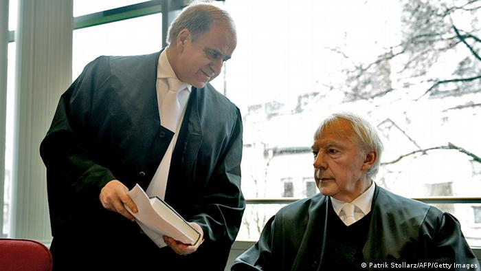 Karim Popal (L) and Peter Derleder, representative of Abdul Hanan, father of two victims who died after German bombing in Kundus, arrive at the Regional Court in Bonn, western Germany on March 20, 2013 to stand trial for 91 victims who died in Kundus in September 2009 after US bombers destroyed two gas trucks ordered by a German colonel Georg Klein. AFP PHOTO / PATRIK STOLLARZ (Photo credit should read PATRIK STOLLARZ/AFP/Getty Images)