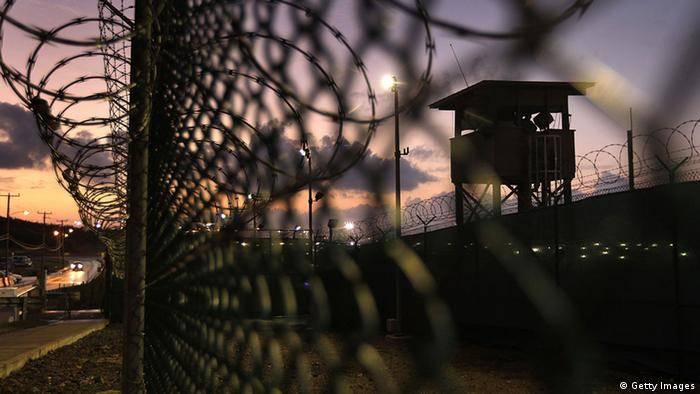 GUANTANAMO BAY, CUBA - MARCH 30: (EDITORS NOTE: Image has been reviewed by U.S. Military prior to transmission.) A guard tower stands at the perimeter of Camp Delta in the Guantanamo Bay detention center on March 30, 2010 in Guantanamo Bay, Cuba. U.S. President Barack Obama pledged to close the prison by early 2010 but has struggled to transfer or try the remaining detainees from the facility, located on the U.S. Naval Base at Guantanamo Bay, Cuba. (Photo by John Moore/Getty Images)