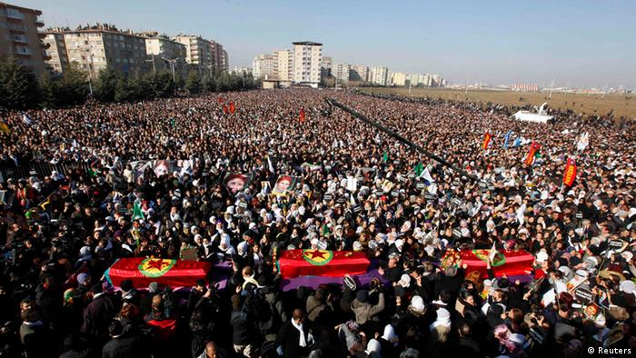 Thousands attend the funeral ceremony of the three Kurdish activists, including PKK co-founder Sakine Cansiz who were shot in Paris, in Diyarbakir, in this January 17, 2013 file photograph. Jailed Kurdish militant leader Abdullah Ocalan is set to call on his fighters to halt hostilities with Turkey on March 21, 2013 in a peace process which marks the best hope yet of ending a conflict that has killed 40,000 and handicapped the country for decades. REUTERS/Umit Bektas/Files (TURKEY - Tags: POLITICS OBITUARY CIVIL UNREST)