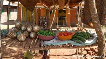 A market stall in Uganda full of vegetables and fruits.