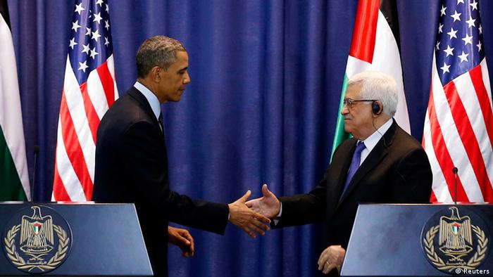 U.S. President Barack Obama and Palestinian President Mahmoud Abbas (R) shake hands at a news conference at the Muqata Presidential Compound in the West Bank City of Ramallah March 21, 2013. REUTERS/Larry Downing (WEST BANK - Tags: POLITICS)