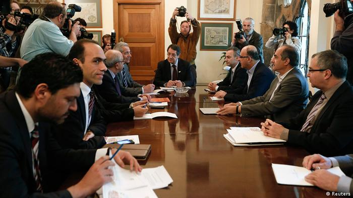 Anastasiades meeting with party leaders and Central Bank of Cyprus officials at the presidential palace in Nicosia (c) Reuters
