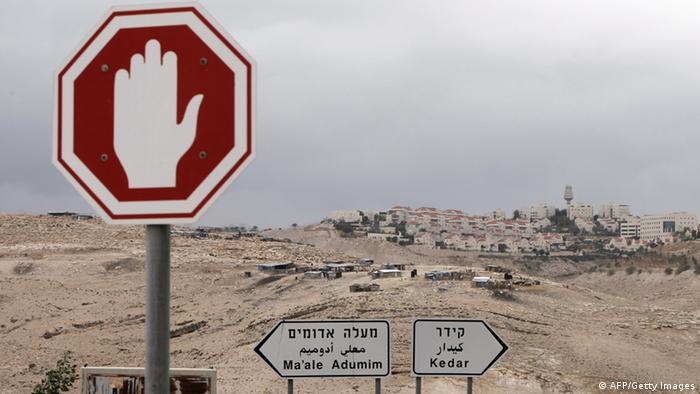 A Bedouin camp is seen near the Israeli settlement of Maale Adumim (background) in the occupied West Bank on the outskirts of Jerusalem on December 5, 2012. If Israel moves ahead with settlement construction in a sensitive strip of West Bank land near Jerusalem it will mean the end of the peace process, Palestinian negotiator Saeb Erakat told AFP. AFP PHOTO/AHMAD GHARABLI (Photo credit should read AHMAD GHARABLI/AFP/Getty Images)