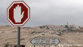 sign with hand on it