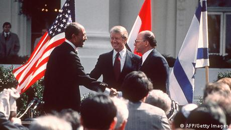 US President Jimmy Carter congratulates Egyptian President Anwar al-Sadat and Israeli Premier Menachem Begin