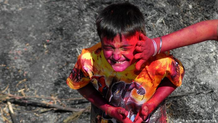 A boy from the state of Rajasthan celebrates Holi, also called the Festival of Colors, in Chennai, India, 01 March 2010. Holi heralds the beginning of spring and is celebrated by Hindus across the world. EPA/NATHAN G.