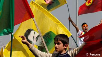 Demonstrators hold Kurdish flags and flags with portraits of jailed Kurdistan Workers Party (PKK) leader Abdullah Ocalan during a gathering to celebrate Newroz in the southeastern Turkish city of Diyarbakir March 21, 2013. Ocalan ordered his fighters on Thursday to cease fire and withdraw from Turkish soil as a step to ending a conflict that has killed 40,000 people, riven the country and battered its economy. Hundreds of thousands of Kurds, gathered in the regional centre of Diyarbakir, cheered and waved banners bearing Ocalan's moustachioed image when a letter from the rebel leader, held since 1999 on a prison island in the Marmara Sea, was read out by a pro-Kurdish politician. REUTERS/Umit Bektas (TURKEY - Tags: POLITICS CIVIL UNREST) ags: POLITICS CIVIL UNREST TPX IMAGES OF THE DAY)