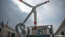 A mock wind turbine with a knotted stem is seen during a protest outside the Chancellery in Berlin, March 21, 2013. German Chancellor Angela Merkel has invited Germany's state ministers to discuss the progress of Germany's transition to renewable energy. REUTERS/Thomas Peter (GERMANY - Tags: POLITICS CIVIL UNREST ENERGY)